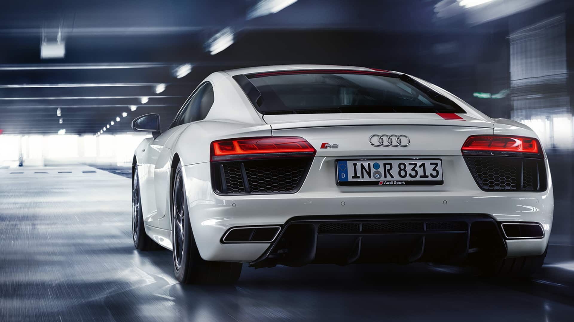 Bold proportions dominate the rear of the audi r8 coup v10 rws however overall it has become 50 kilos lighter compared to the audi r8 coup v10 with
